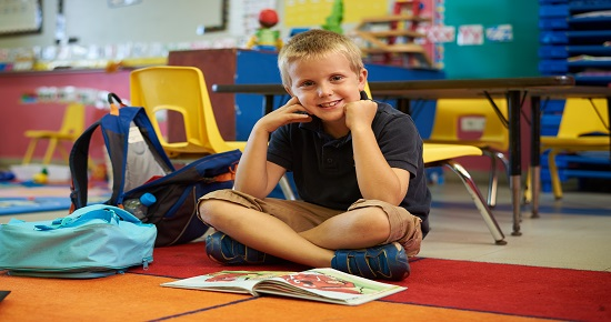boy reading in classroom